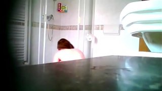 Chubby Brunette takes a Shower 2  Spy Cam Clip